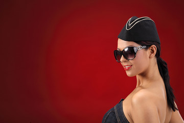 Sexy stewardess. Red background. fly and fun concept