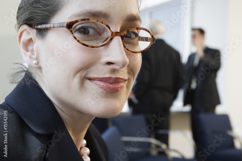 Portrait of a businesswoman smiling in an office.