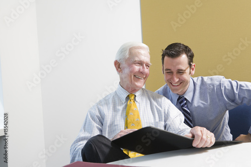 Businesspeople smiling in an office.