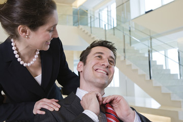 Business colleague getting congratulated on success.