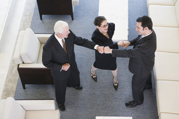 Successful executives congratulating themselves.