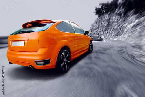 Foto op Canvas Snelle auto s Beautiful orange sport car on road