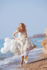 Bride running on beach