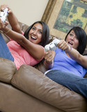 Two beautiful women playing video games poster