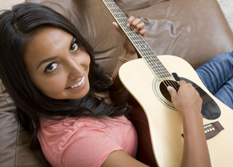A beautiful woman playing the guitar