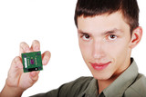 Young male holding computer processor poster