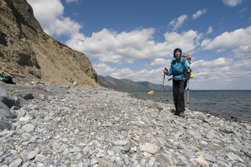 Backpacker on coast
