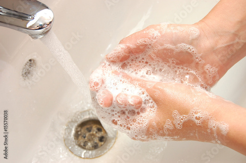 woman washing hand under running water