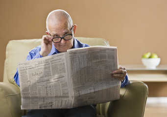 Elderly Man Reading Newspaper