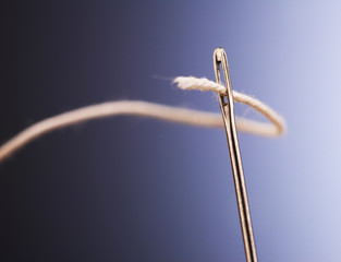 Needle with a thread
