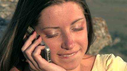 young woman speaking mobile phone on sunset HD