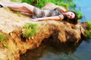 woman lays near water