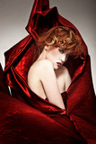 Fine art style photo of a beautiful redhead woman