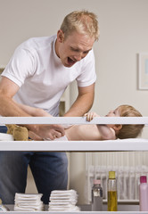 Father Changing Diapers