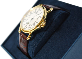 Golden watch on blue
