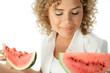 Portrait of young woman holding slices of watermelon