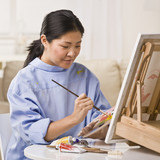 Woman Painting Picture