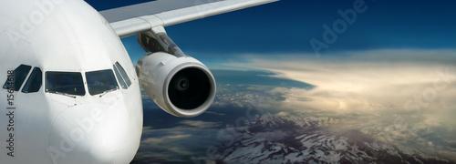 Leinwandbild Motiv Plane above morning Earth