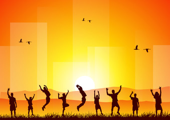Happy people jumping at sunset