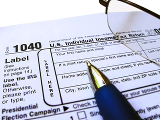 glasses, pen and 1040 Individual tax return form