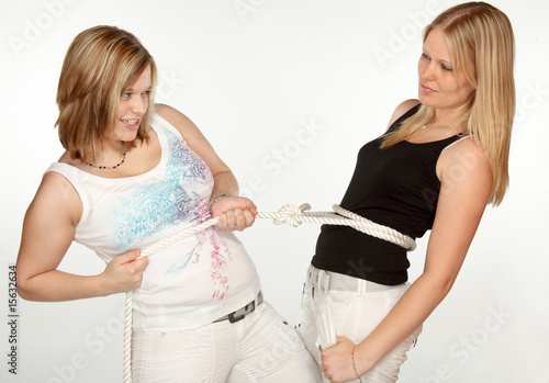 Two young ladies and a rope