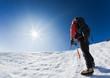 Climber reaching the summit of a mountain peak