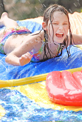 Young girl having fun on waterslide