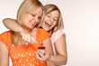 Two young ladies with a cell phone