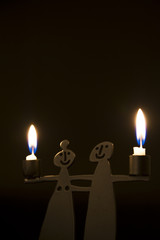 toy of couple holding candle