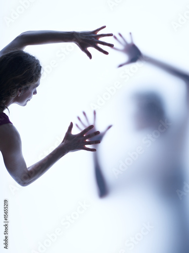 Two people reaching out to each other