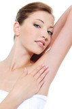 Woman stroking her clean fresh armpit