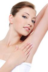 Woman stroking her clean fresh armpit