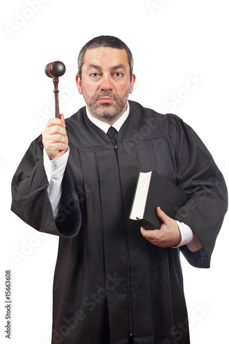 Judge holding the gavel and book - 15663608