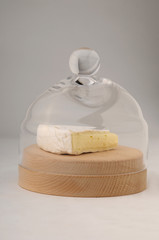 The piece of cheese in glass jar