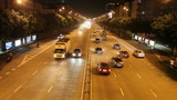 Time Lapse of night traffic on city boulevard poster
