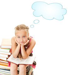 Little schoolgirl sitting on a stack of books....
