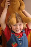 The little girl with the plush teddy bear poster