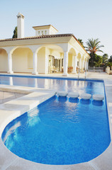 Outdoor pool and building with pillars