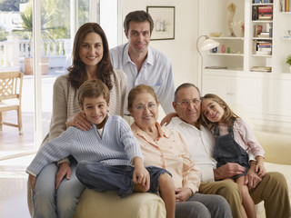 Boy and girl posing with parents and grandparents