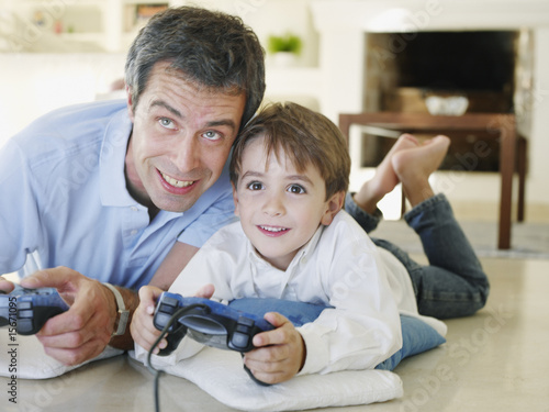 Father and son playing video game together