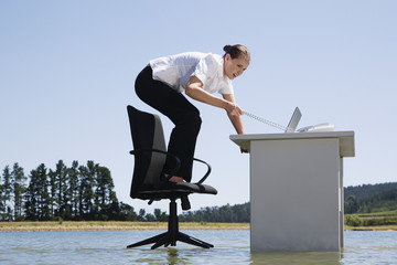 A woman on her office chair on top of water