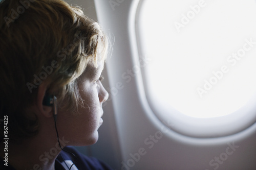 A child looking out his airplane window