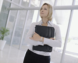 Businesswoman holding attache case