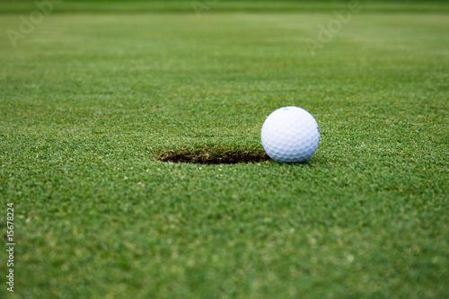 Leinwandbild Motiv Golf ball on the way to the hole