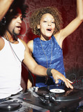 A DJ and a woman at a club
