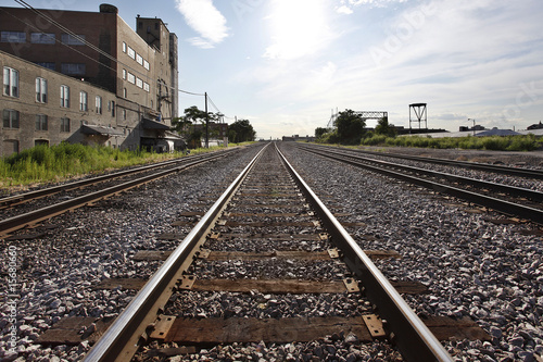 Train tracks along industrial area