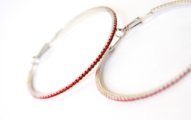 jewellery earrings with brilliant red stresses