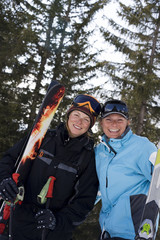 Two female skiers smiling at the camera