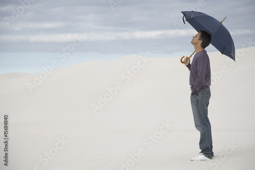 A man with an umbrella outdoors