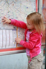 little girl in front the map